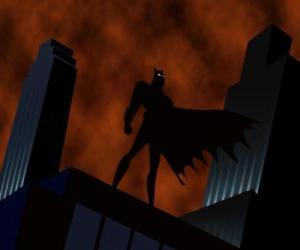 Puzzle de Batman, el hombre murciélago, vigilando la ciudad desde la azotea de un edificio de Gotham City