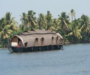 Puzzle de Casa flotante por el río, un barco diseñado como vivienda