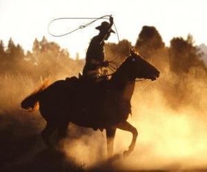 Puzzle de Cowboy o vaquero cabalgando con el lazo