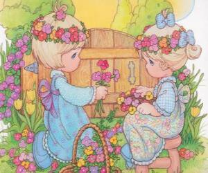 Puzzle de Dos niñas recogen flores. Precious Moments