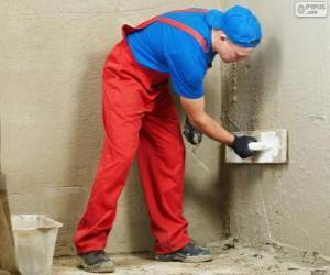 Puzzle de Estucador trabajando en el revestimiento de una pared