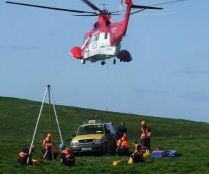 Puzzle de Grupo de rescate con vehículo terrestre y aéreo