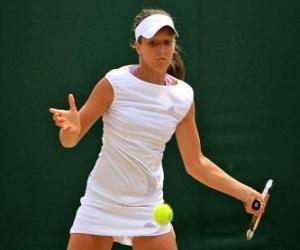 Puzzle de Jugadora de tenis preparada para un golpe
