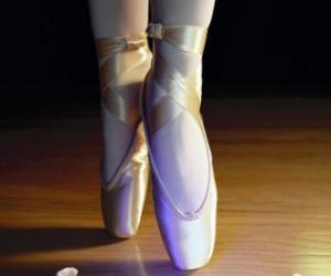Puzzle de Los pies de una bailarina con las zapatillas de ballet