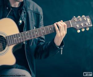 Puzzle de Músico tocando la guitarra