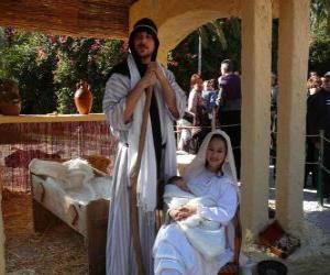 Puzzle de Maria, San José y el Niño Jesús en el pesebre viviente