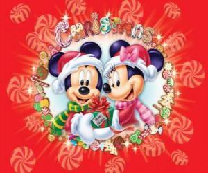 Puzzle de Mickey y Minnie Mouse abrigados con los sombreros de Santa Claus