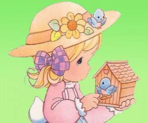 Puzzle de Niña con un pajarito. Precious Moments
