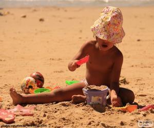 Puzzle de Niña jugando en la playa