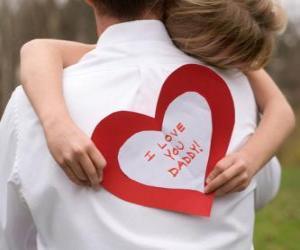 Puzzle de Niña felicitando a su padre con un abrazo y un corazón de papel