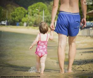 Puzzle de Padre y su hija en la playa