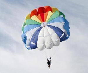Puzzle de Paracaidista descendiendo entre las nubes en un paracaídas despues de saltar desde una avioneta