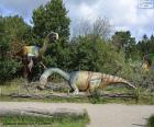 Grupo de tres dinosaurios en el paisaje