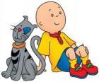 Caillou sentado en el suelo con su gato Gilbert