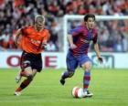 Jugador de futbol (Bojan Krkic F.C.B) conduciendo el balón