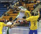 Balonmano - Jugador en el salto para un lanzamiento
