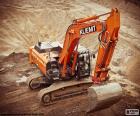 Gran excavadora oruga de color naranja en la obra
