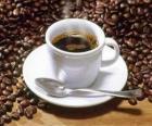 Taza de café con leche con platito y cucharita