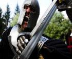 Guerrero luchando en una batalla