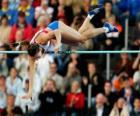 Atleta realizando un salto con pértiga
