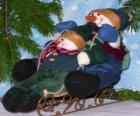 Muñecos de nieve bajando en trineo