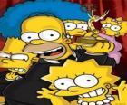 Los Simpson recogiendo un premio