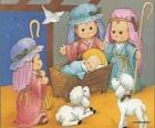 Jesús en el pesebre junto con José, Maria y un pastor con sus ovejas
