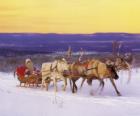Trineo navideño tirado por los renos y cargado con los regalos y Papá Noel