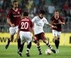 Acción de un partido de futbol en el estadio