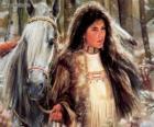 Joven india junto a su caballo