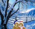 dos ositos muy abrigados en un paisaje navideño