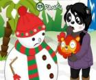 Muñeco de nieve sin nariz ya que pompom se la quiere comer ante la sorpresa de Penny
