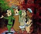 Los protagonistas de las aventuras: el Oso Yogui, Bubú, la osa Cindy y el guardia del parque Smith