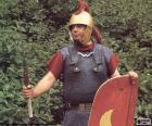 Un soldado romano, un legionario armado con el pilum (la lanza), la espada, el casco, la armadura y el escudo