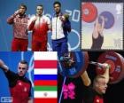 Podio Halterofilia 85 kg masculino, Adrian Zieliński (Polonia), Apti Aujadov (Rusia) y Kianoush Rostami (Irán) - Londres 2012 -