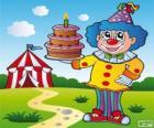 Payaso con un pastel de aniversario