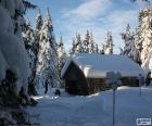 Cabaña de madera nevada