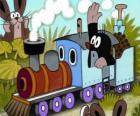 Krtek, el pequeño topo en una locomotora de vapor