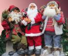 Tres muñecos de Papá Noel