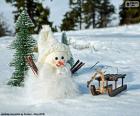 Muñeco de nieve y trineo