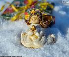 Ángel de Navidad, rezando