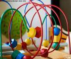 Juguete de madera y metal para mejorar las habilidades motoras de los niños