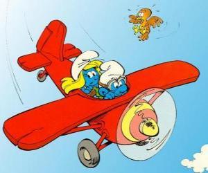 Puzzle de Un Pitufo y Pitufina volando en una avioneta roja