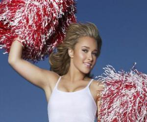 Puzzle de Una cheerleader o animadora con los pompones durante el espectáculo