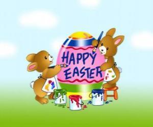Puzzle de Una pareja de conejitos están pintando huevos para la Pascua